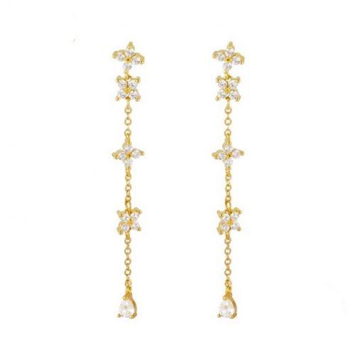 Pendientes Largos Flor Oro para fiesta evento. Sofisticados. De oro con diamantes circonitas en forma de pétalos de flor.